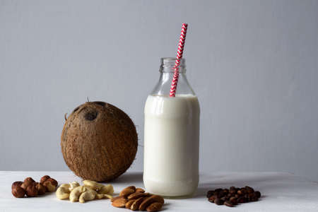 variants of raw vegan milk from different nuts Stock Photo