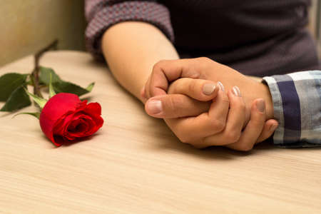 Romantic dating. Male and female hands caressing with love. Couple on  dating at coffee shop. Stok Fotoğraf