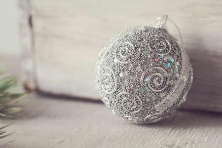 silver Christmas ball near vintage wooden box Stock Photo - 84180204