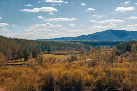 landscape with the Ural mountains and autumn forest on a sunny day
