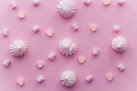 Pink sweets top view pattern on pink pastel background