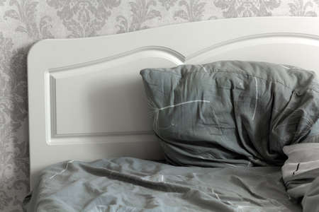 part of the bed with headboard and pillow Stock Photo