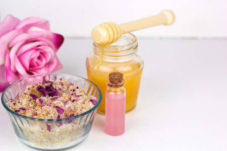 homemade sea solt scrub with rose petals,aroma oil and honey Stock Photo