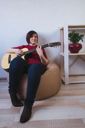 beautiful young woman playing guitar