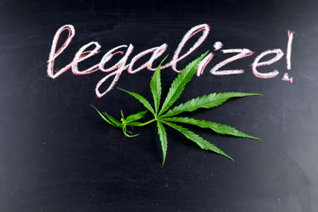top view marihuana leaf with inscription legalize on a chalkboard Stock Photo