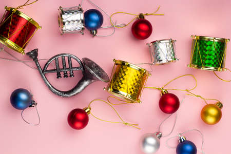 stock photo top view christmas decorations on a pastel pink background