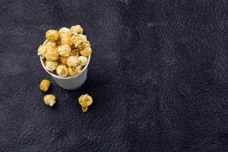 top view pop corn on a black background Stock Photo