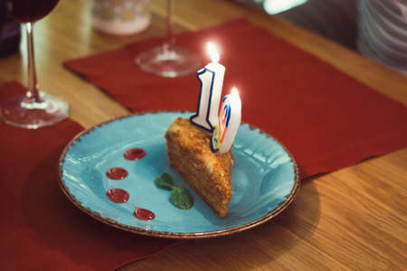 piece of cake with the number nineteen in honor of the birthday celebration  in the restaurant