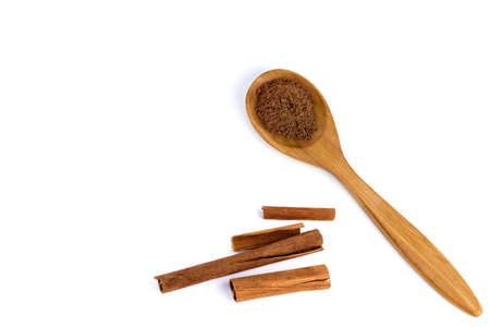top view of a spoon of sandal wood with cinnamon  isolated on white background