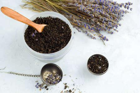 top view dry lavender flowers, honey jar,  sea salt, spa set on white shabby concrete background
