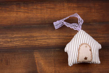 top view cute stripped stuffed toy in a shape of house on a wooden background Banco de Imagens