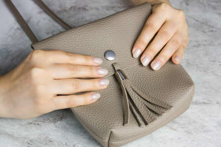 close up of beautiful female hands with manicure on marble table,  healthy hands skin and nails concept 스톡 콘텐츠