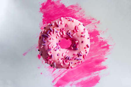 pink doughnut on a watercolor background