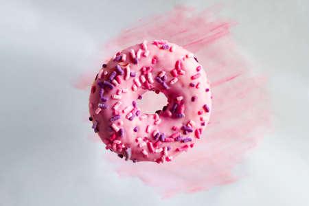 pink doughnut on a pastel watercolor background Banco de Imagens