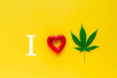 marijuana and red heart on a yellow background, i love marijuana concept