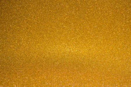 abstract blurred golden background with shiny bokeh Banco de Imagens