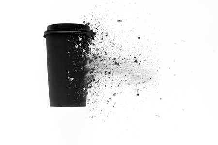 top view of the disposable coffee cup is decomposed into small pieces, ecological concept