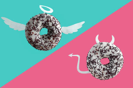angel and devil donuts on a blue and pink background