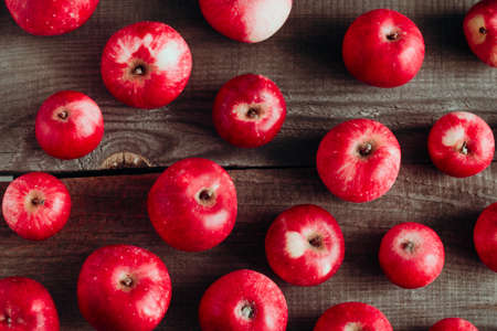 top view red apples harvest pattern  on a wooden boards