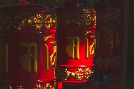 Saint Petersburg, Russia, 25 June 2019 -close up red buddhist temple drums with carved with golden letters mantras Editorial