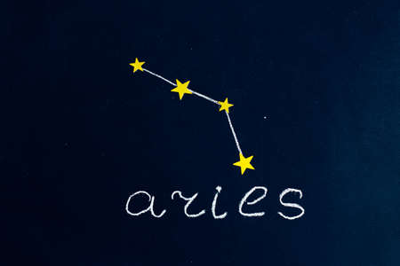 constellation Aries drawn in chalk and gold stars on a chalkboard looking like a night starry sky 스톡 콘텐츠