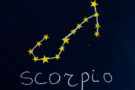constellation Scorpio drawn in chalk and gold stars on a chalkboard looking like a night starry sky 스톡 콘텐츠
