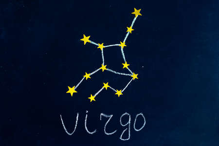 constellation Virgo drawn in chalk and gold stars on a chalkboard looking like a night starry sky