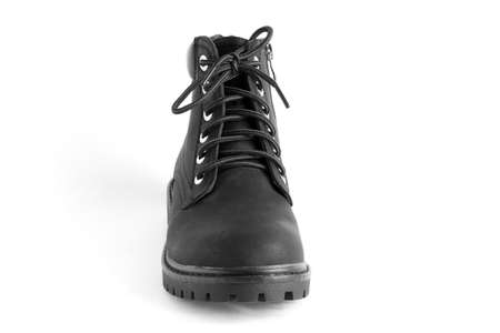 black heavy duty unisex boots isolated on white background, shoes for autumn winter season Imagens