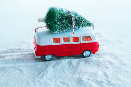 cute winter holidays greeting card  christmas tree on retro toy truck in snowy forest