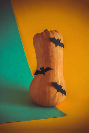 pumpkin with decorated with paper  cut bats retro toned halloween card Imagens