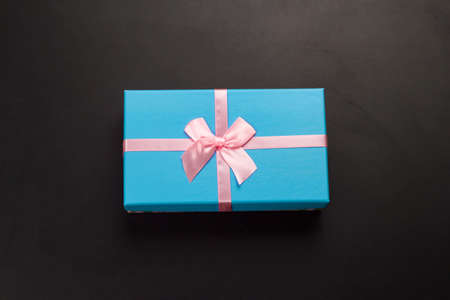 top view blue gift box on a black background