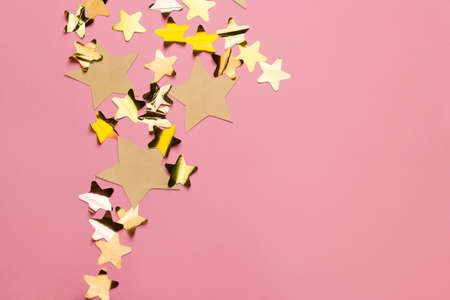 golden stars on a pink background with free space for text