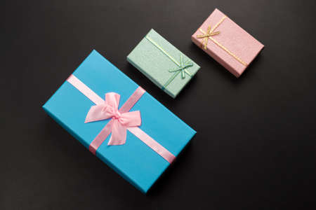 top view three gift boxes on a black background ,holiday sales concept
