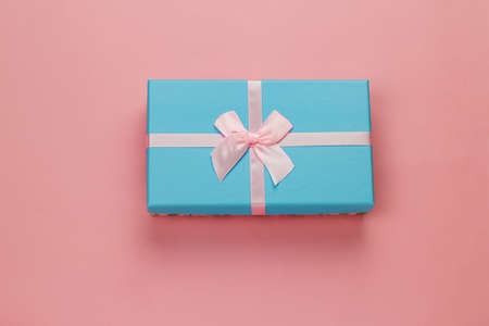 top view cute blue  present box on a pastel pink background