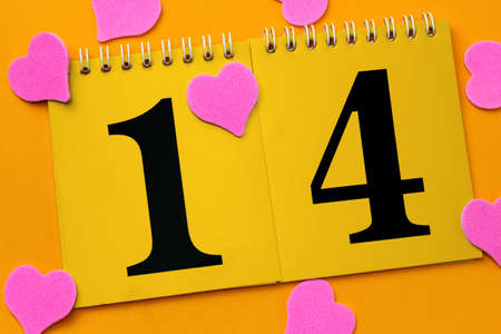 calendar with number 14 on a  yellow background with pink hearts mess on bright yellow background, Saint Valentine concept