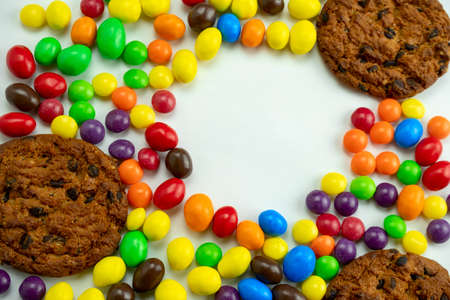 sweet colourful candies and  cookies  top view, unhealthy lifestyle and diet concept copy space Zdjęcie Seryjne