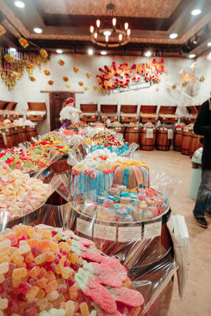 Yekaterinburg, Russia, 25 November 2019 - barrels with different types of marmalade in the candy store