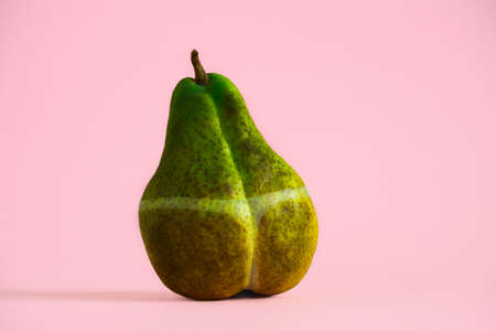 dark overexposed pear with traces of sunburn, creative concept summer vacation sunburn