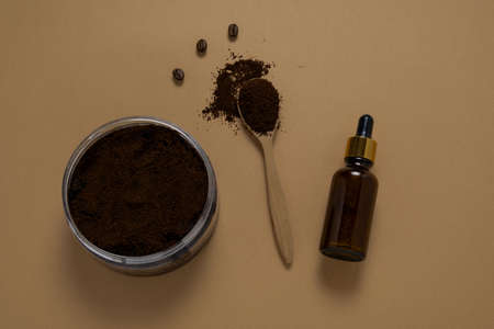 top view homemade scrub diy kit, oil and ground coffee beans, selective focus Stock Photo
