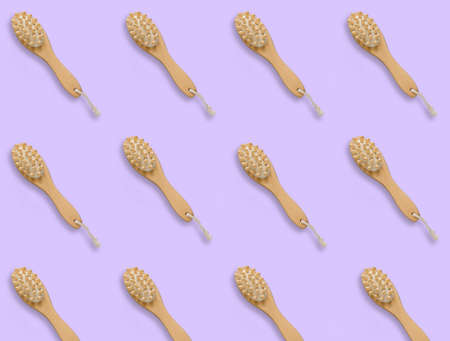 top view pattern brush for dry skin massage on a pastel violet background,copy space Banco de Imagens