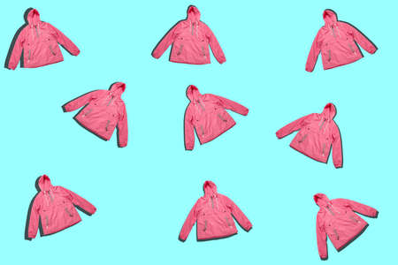 pattern of pink raincoats isolated on a blue background