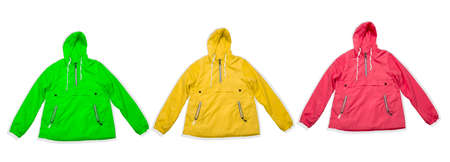 trendy yellow, green and pink raincoats isolated on a white background banner