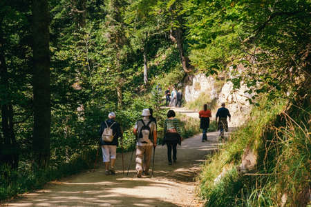 Sochi, Russia, 17 September 2020 -group of tourists walking in a mountain road