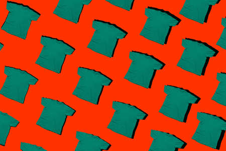 green t shirts pattern isolated on a red background