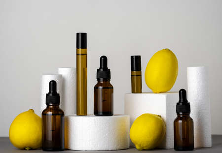 Modern cosmetic products still life set of cometic oils and lemons on product stands Banco de Imagens - 164969291