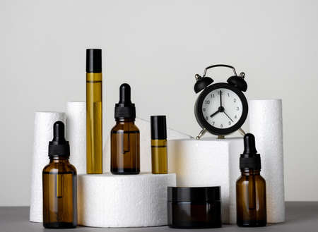 Cosmetic products and clock, morning and evening skin and body care concept Banco de Imagens - 164969607