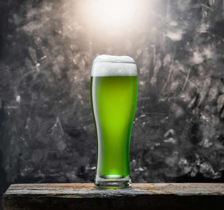 Green beer for St. Patrick's day on a wooden surface on a background of a chalkboard Banco de Imagens - 164969639