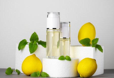 Jars of perfume, lemons and mint leaves. Beauty concept, modern still life.