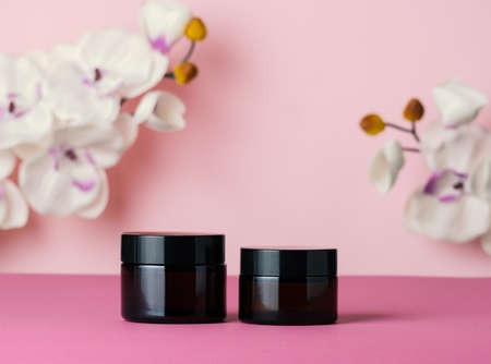 Cosmetic products jars on a pink background. Skin care concept. Banco de Imagens - 166089928