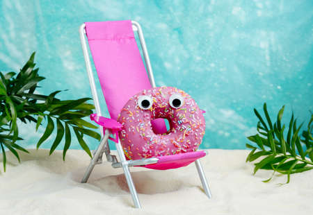 Funny summer card with donut relaxing on beach chair. Summer minimal food humor poster.